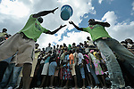 People move buckets of food and other emergency supplies into the Santa Teresa camp in Petionville, Haiti, on February 1. Hundreds of families left homeless by the devastating January 12 earthquake live here. The ACT Alliance sponsored this distribution of food, buckets, and hygiene kits.