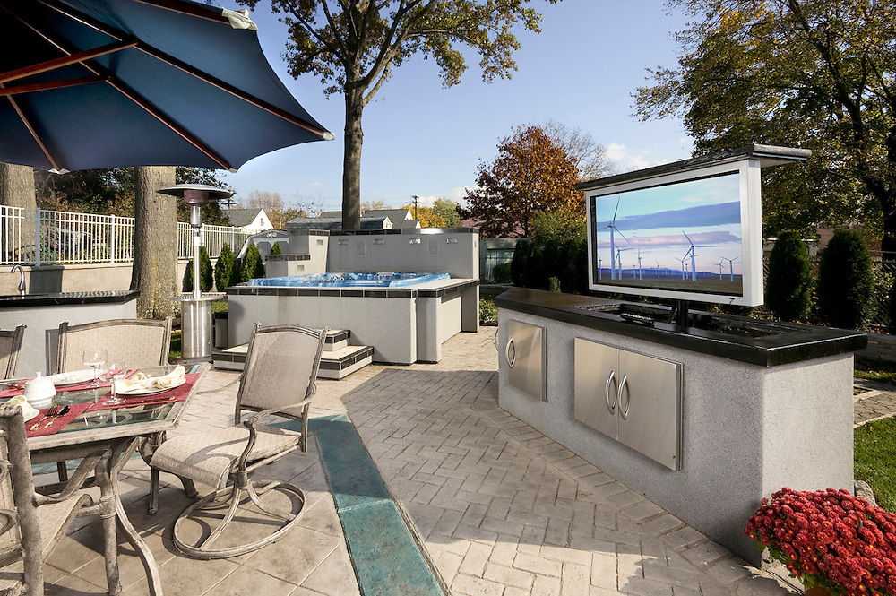 Outdoor Entertainment Area with Pop-Up TV and Automation