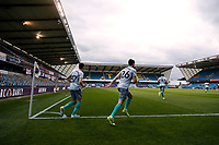 14th July 2020; The Den, Bermondsey, London, England; English Championship Football, Millwall Football Club versus Blackburn Rovers; Darragh Lenihan and Joseph Rankin-Costello of Blackburn Rovers run out onto the pitch from the away team tunnel into an empty The Den Stadium before kick off