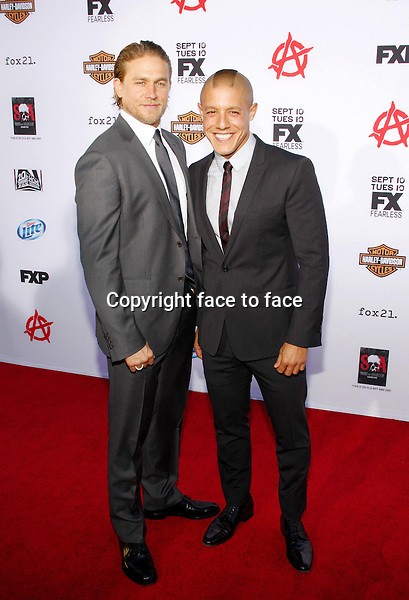 "Charlie Hunnam and Theo Rossi at the FX's Season 6 Premiere Screening of ""Sons Of Anarchy"" held at the Dolby Theatre in Hollywood on September 7, 2013 in Los Angeles, California. Credit: PopularImages/face to face"