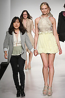Senior fashion designer Sunjee Kim, walks runway with model, at the close of the Pratt 2011 fashion show.