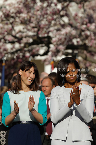 First Lady Michelle Obama (R) and Samantha Cameron talk during the official arrival ceremony at the South Lawn of the White House March 14, 2012 in Washington, DC. Prime Minister Cameron is on a three-day visit to the U.S. and he is expected to have talks with Obama on the situations in Afghanistan, Syria and Iran. .Credit: Chip Somodevilla / Pool via CNP