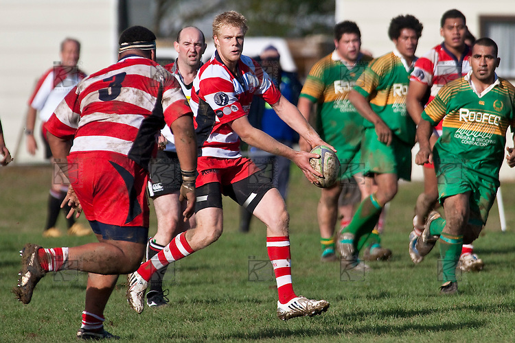 Baden Kerr looks to offload to Uini Antonio. Counties Manukau Club rugby Premier game between Drury and Karaka played at Drury on Saturday May 1st, 2010. Karaka won the game 32 -12 after leading 25 - 7.