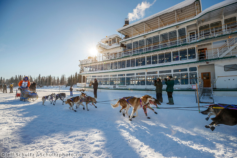Cindy Abbott mushing past the Riverboat Discovery during the re-start of the 2017 Iditarod in Fairbanks, Alaska at Pike's Landing on Monday March 6, 2017.<br /> <br /> Photo by Jeff Schultz/SchultzPhoto.com  (C) 2017  ALL RIGHTS RESVERVED