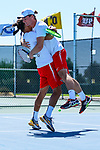 SURPRISE, AZ - MAY 12: Pierre Montrieul, left, hugs teammate Blake Blaydon of the Barry Buccaneers after winning a match against Kiranpal Pannu and Matei Avram of the Columbus State Cougars during the Division II Men's Tennis Championship held at the Surprise Tennis & Racquet Club on May 12, 2018 in Surprise, Arizona. (Photo by Jack Dempsey/NCAA Photos via Getty Images)