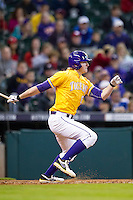 LSU Tigers outfielder Andrew Stevenson (6) follows through on his swing during the Houston College Classic against the Nebraska Cornhuskers on March 8, 2015 at Minute Maid Park in Houston, Texas. LSU defeated Nebraska 4-2. (Andrew Woolley/Four Seam Images)