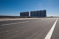 Daytime landscape view of a Suburban High Rise Residential Development under construction in Tianjin, China.  © LAN