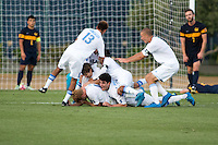 BERKELEY, CA - Oct. 13, 2016: UCLA players celebrate scoring a goal against Cal.  Cal Men's Soccer played UCLA on Goldman Field at Edwards Stadium.
