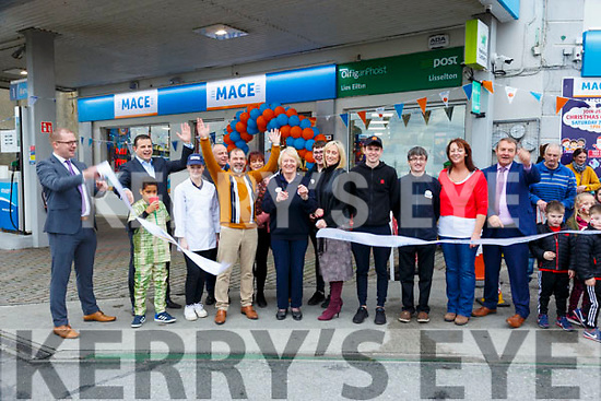 Ryan's Mace Foodstore Opening: The longest serving member of Ryans Foodstore, Liselton, Maureen Flavin cutting the tape to the opening of the new Mace store on Saturday last.