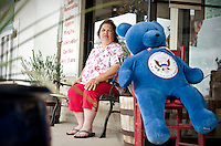 Raydean Damon (cq), owner and operator of The Red Bull gift shop and Bush memorabilia store, sits outside her shop in Crawford, Texas, US, Wednesday, April 14, 2010. The Red Bull store is the last remaining gift shop in Crawford...PHOTO/ MATT NAGER