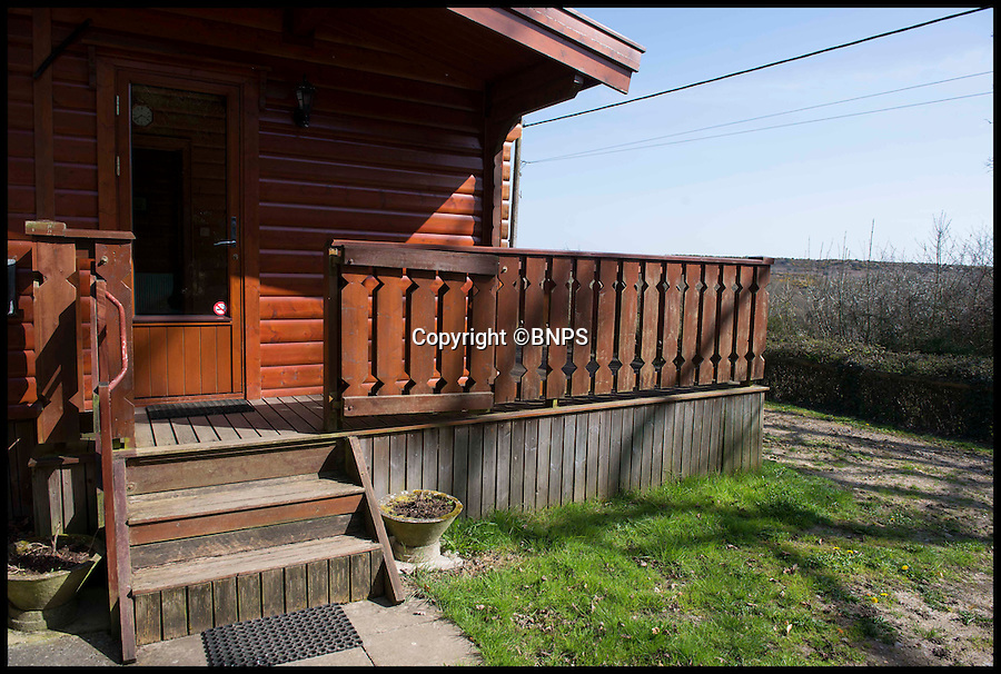BNPS.co.uk (01202 558833)<br /> Pic: LauraDale/BNPS<br /> <br /> The log cabin's front door.<br /> <br /> A dream home...at a price - chance to buy your very own log cabin in a wood.<br /> <br /> A rare opportunity has arisen to own this idyllic log cabin nestled in the heart of ancient forest - but prospective buyers will have to dig deep because it comes with a whopping £350,000 price tag.<br /> <br /> The quaint wooden retreat is down a private track in the the New Forest, the medieval hunting grounds of William the Conqueror, offering peace and quiet for those looking to escape the stresses of modern life.<br /> <br /> The woodland bolthole might look like a holiday home but unlike its counterparts it comes with permission to live in it all year round.<br /> <br /> But its ideal location on the edge of a tiny hamlet in the west of New Forest National Park means it is worth more than twice what a similar holiday cabin at a home park would be worth.