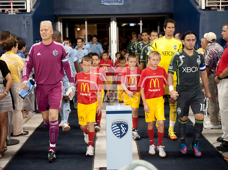 Sporting Kansas City won the Lamar Hunt U.S. Open Cup on penalty kicks after tying the Seattle Sounders in overtime at Livestrong Sporting Park in Kansas City, Kansas.