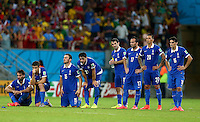 The Greece team shows a look of dejection during the penalty shootout which they lost 5-3 to Costa Rica