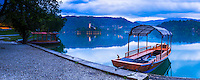 Pletna rowing boat and Lake Bled Island at twilight, Bled, Gorenjska, Slovenia, Europe