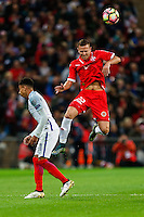 Alex Muscat of Malta (right) wins the ball in the air ahead of Alex Oxlade-Chamberlain (Arsenal) of England (left) during the FIFA World Cup qualifying match between England and Malta at Wembley Stadium, London, England on 8 October 2016. Photo by David Horn / PRiME Media Images.