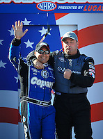 Sept. 6, 2010; Clermont, IN, USA; NHRA top fuel dragster driver Brandon Bernstein (left) and Bob Vandergriff during driver introductions prior to the U.S. Nationals at O'Reilly Raceway Park at Indianapolis. Mandatory Credit: Mark J. Rebilas-