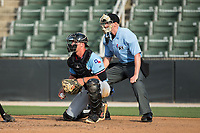 Hickory Crawdads catcher Alex Kowalczyk (22) on defense as home plate umpire Mike Snover looks on during the game against the Kannapolis Intimidators in game one of a double-header at Kannapolis Intimidators Stadium on May 19, 2017 in Kannapolis, North Carolina.  The Crawdads defeated the Intimidators 5-4.  (Brian Westerholt/Four Seam Images)