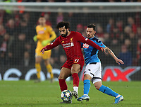 27th November 2019; Anfield, Liverpool, Merseyside, England; UEFA Champions League Football, Liverpool versus SSC Napoli ; Mohammed Salah of Liverpool shields the ball from Mario Rui of SSC Napoli - Editorial Use