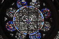 Stained glass window in the South tower, finished 1366, on the Western facade of the Basilique Cathedrale Notre-Dame d'Amiens or Cathedral Basilica of Our Lady of Amiens, built 1220-70 in Gothic style, Amiens, Picardy, France. Amiens Cathedral was listed as a UNESCO World Heritage Site in 1981. Picture by Manuel Cohen
