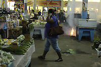 Sellers fired a short length of firecracker under their stalls in the Centarl Market of Paramaribo.  Shoppers and sellers are protecting their ears for preventing permanent damage due loud noise comes from explosion of firecrackers.....End of year 2010 celebrations on the streets of Paramaribo. Suriname is one of biggest consumer in South America that using firecrackers, fireworks ( also locally known as pagara ) for celebrations, especially for end of every years and also beginning of every new Chinese Years.