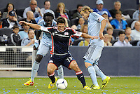 Ryan Guy (13) New England holds off Kei Kamara and Chance Myers Sporting KC... Sporting Kansas City defeated New England Revolution 3-0 at LIVESTRONG Sporting Park, Kansas City, Kansas.