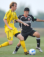 U.S. Open Cup Round of 16: Columbus Crew's Tim Ward (20) dribbles the ball in front of DC United's Alecko Eskandarian (11). DC United defeated the Columbus Crew in overtime 2-1, Tuesday, August 1, 2006, at Maryland Soccerplex.