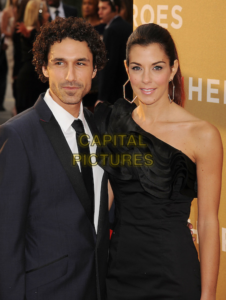 Ethan Zohn, Jenna Morasca.CNN Heroes: An All-Star Tribute 2011 held at The Shrine Auditorium, Los Angeles, California, USA..December 11th, 2011.half length suit black white tie one shoulder dress couple .CAP/ROT/TM.©Tony Michaels/Roth Stock/Capital Pictures