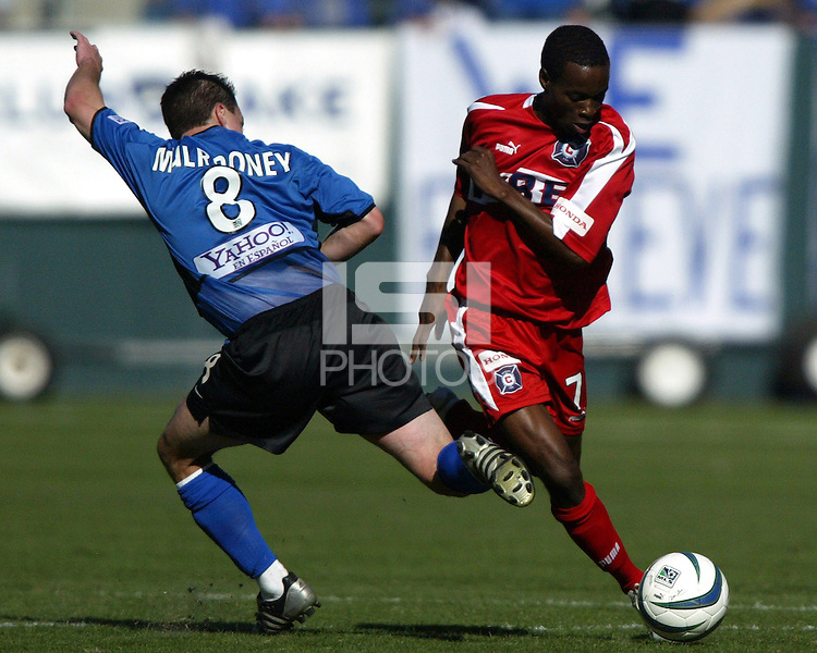 Richard Mulrooney tries to tackle the ball away from DaMarcus Beasley during MLS Cup 2003.  The San Jose Earthquakes defeated the Chicago Fire 4-2 in the MLS Championship at The Home Depot Center on November 23, 2003.