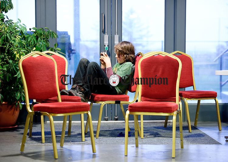 Chairman.......Oisin Cullen of Lahinch finds a quiet corner to play a game on his phone during the Burren Food Fayre in the Pavilion, Lisdoonvarna as part of the Burren Winterage Weekend. Photograph by John Kelly.