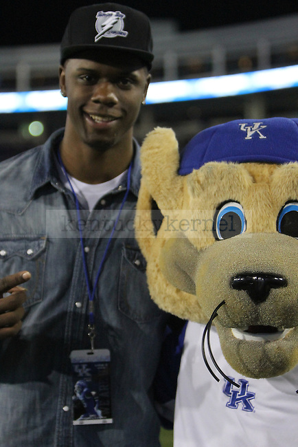 Terrance Jones poses for a picture with UK's mascot during the University of Kentucky football game against Western Kentucky University, and Commonwealth Stadium in Lexington, Ky., on Saturday September 15th. Photo by Kirsten Holliday