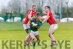 Prime Beef: Kerry Jonathan Lyne is the meat in Cork's Ruairi Deane and Peter Kelleher sandwich during the McGrath cup clash in Mallow on Sunday
