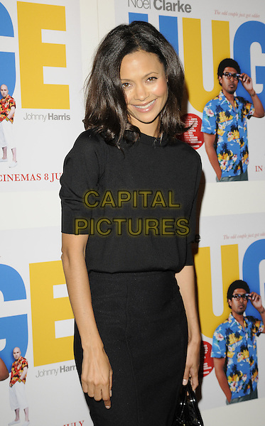 "Thandie Newton.The ""Huge"" UK premiere, Empire Cinema, London, England..June 27th, 2011.half length black dress smiling .CAP/CAN.©Can Nguyen/Capital Pictures."
