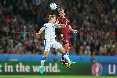 15.06.2016. Lille, France. UEFA Euro 2016 Group B soccer match Russia and Slovakia at Stade Pierre Mauroy in Lille Metropole, France, 15 June 2016.  Tomas Hubocan (Slo) and Aleksandr Kokorin (Rus) challenge for the header