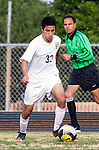 Palos Verdes, CA 01/22/13 - Peyman Dalirifar (Peninsula #32) in action during the West vs Peninsula boys varsity soccer game at Peninsula High School.
