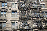 Fire escape on the exterior of a tenement apartment building in theKips Bay neighborhood of New York on Tuesday, June 30, 2015. (© Richard B. Levine).