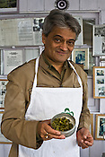 Rajah Banerjee, the owner of Makaibari Tea Estate, talks of tea and poses for a portrait with his finest produce and also his favourite Bai-mu-dan tea leaves at the Makaibari Tea estate, in Darjeeling, India.