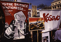 May 8, 1999; Paris; FRANCE; Slogans against ethnic purification in Kosovo .