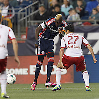 New England Revolution substitute forward Saer Sene (39) passes the ball. In a Major League Soccer (MLS) match, the New England Revolution (blue) tied New York Red Bulls (white), 1-1, at Gillette Stadium on May 11, 2013.