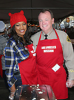 Los Angeles, CA - NOVEMBER 23: Garcelle Beauvais, Sheriff Jim McDonnell, At Los Angeles Mission Thanksgiving Meal For The Homeless At Los Angeles Mission, California on November 23, 2016. Credit: Faye Sadou/MediaPunch