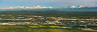 Panoramic view of the city of Fairbanks, Alaska, situated on the edge of the Tanana valley flats. the high peaks of the Alaska Range mountains along the distant horizon (Mount Deborah, Hess and Hayes from right to left).
