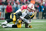 Wisconsin Badgers linebacker Shane Connelly (43) tackles Iowa Hawkeyes running back James Butler (20) during an NCAA College Big Ten Conference football game Saturday, November 11, 2017, in Madison, Wis. The Badgers won 38-14. (Photo by David Stluka)