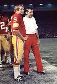 Washington, D.C. - (File Photo) -- Washington Redskin quarterback Sonny Jurgensen (9), left, and head coach George Allen, right, watch action on the field in this undated photo taken at RFK Stadium in Washington, D.C..Credit: Arnie Sachs / CNP