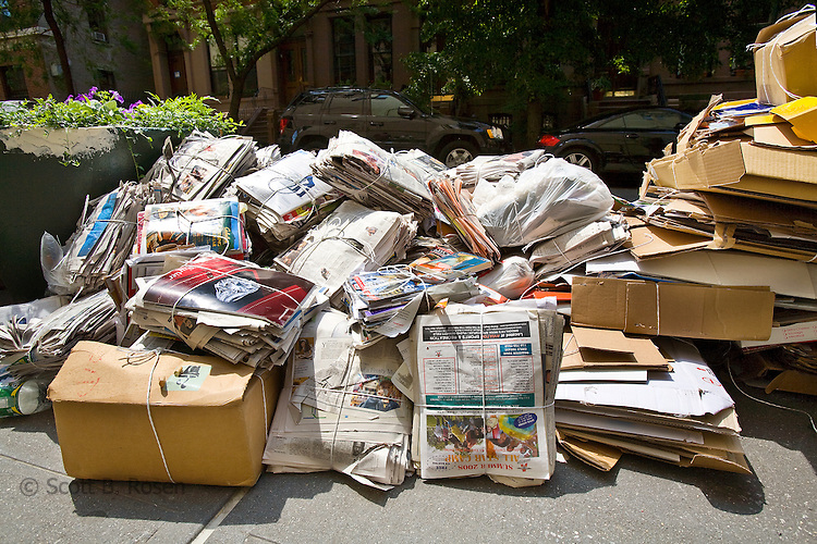 Cardboard, newspapers, and magazines bundled for curbside recycling program in Brooklyn Heights, New York