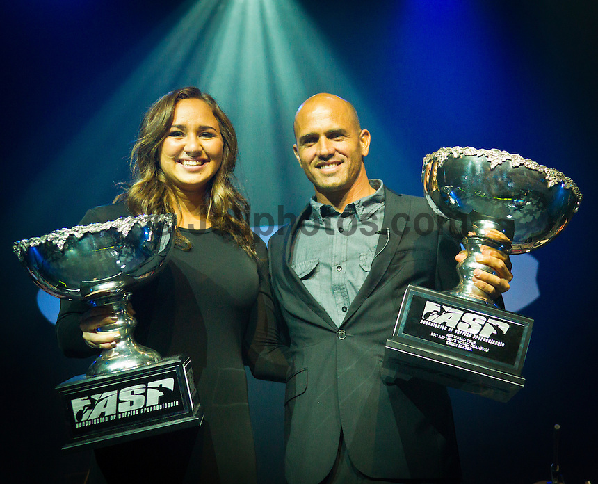 GOLD COAST, Queensland/Australia (Friday, February 24, 2012) Carissa Moore (HAW) and Kelly Slater (USA)  x 11 World Champion.  The 29th Annual ASP World Surfing Awards went off tonight at the Gold Coast Convention and Exhibition Centre with the worlds best surfers trading the beachwear for formal attire as the 2011 ASP World Champions were officially crowned.. .Kelly Slater (USA), 40, and Carissa Moore (HAW), 19, took top honours for the evening, collecting the ASP World Title and ASP Womens World Title respectively.. .I have actually been on tour longer than some of my fellow competitors have been alive, Slater said. All joking aside, its truly humbling to be up here and honoured in front of such an incredible collection of surfers. I want to thank everyone in the room for pushing me to where I am...In addition to honouring the 2011 ASP World Champions, the ASP World Surfing Awards included new accolades voted on by the fans and the surfers themselves...For the first time in several years, ASP Life Membership was awarded to Hawaiian legend and icon of high-performance surfing, Larry Bertlemann (HAW), 56...Where surfing is today is where I dreamed it should be in the 70s, Bertlemann said. You guys absolutely deserve this and Im so honored to be up here in front of you all tonight..Grammy Award-winning artists Wolfmother and The Vernons rounded out the nights entertainment which was all streamed LIVE around the world on YouTube.com..Photo: joliphotos.com