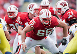 November 14, 2009: Wisconsin Badgers offensive lineman Peter Konz (66) prepares to block during an NCAA football game against the Michigan Wolverines at Camp Randall Stadium on November 14, 2009 in Madison, Wisconsin. The Badgers won 45-24. (Photo by David Stluka)