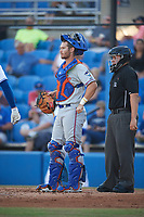 St. Lucie Mets catcher Patrick Mazeika (11) and umpire J.C. Velez during a game against the Dunedin Blue Jays on April 20, 2017 at Florida Auto Exchange Stadium in Dunedin, Florida.  Dunedin defeated St. Lucie 6-4.  (Mike Janes/Four Seam Images)