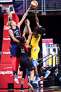 Washington, DC - June 15, 2018: Chicago Sky forward Cheyenne Parker (32) has her shot blocked by Washington Mystics guard Elena Delle Donne (11) during game between the Washington Mystics and Chicago Sky at the Capital One Arena in Washington, DC. (Photo by Phil Peters/Media Images International)