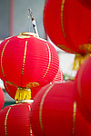 Red round Chinese lanterns hang in multiples for Chinese New Year