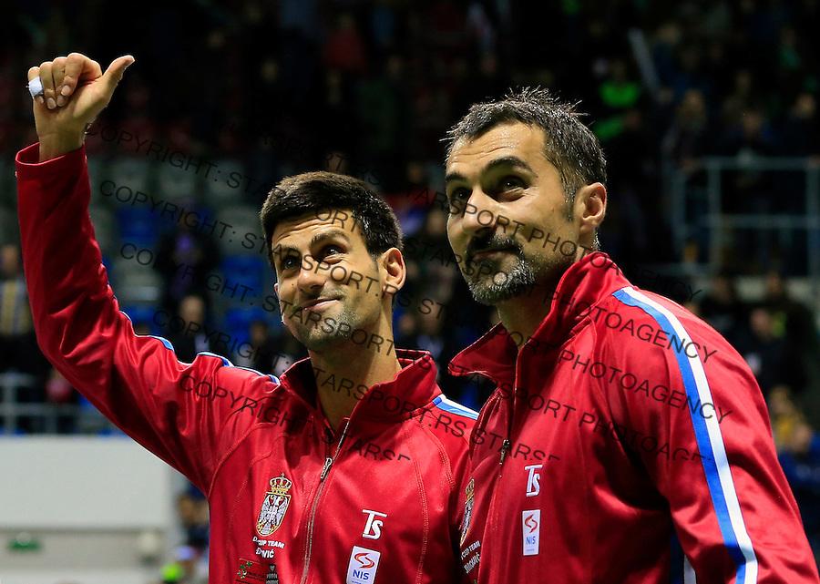 Davis Cup 2014 first round<br /> Srbija v Hrvatska<br /> Novak Djokovic and Nenad Zimonjic-Serbia v Franko Skugor and Marin Draganja doubles dublovi<br /> Novak Djokovic (L) and Nenad Zimonjic<br /> Kraljevo, 07.03.2015.<br /> Foto: Srdjan Stevanovic/Starsportphoto.com&copy;
