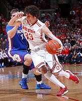 Ohio State Buckeyes guard Amedeo Della Valle (33) fights off American University Eagles forward Kyle Kager (1) during Wednesday's NCAA Division I basketball game at Value City Arena in Columbus on November 20, 2013. Ohio State won the game 63-52.  (Barbara J. Perenic/The Columbus Dispatch)